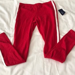 Red leggings with white stripe